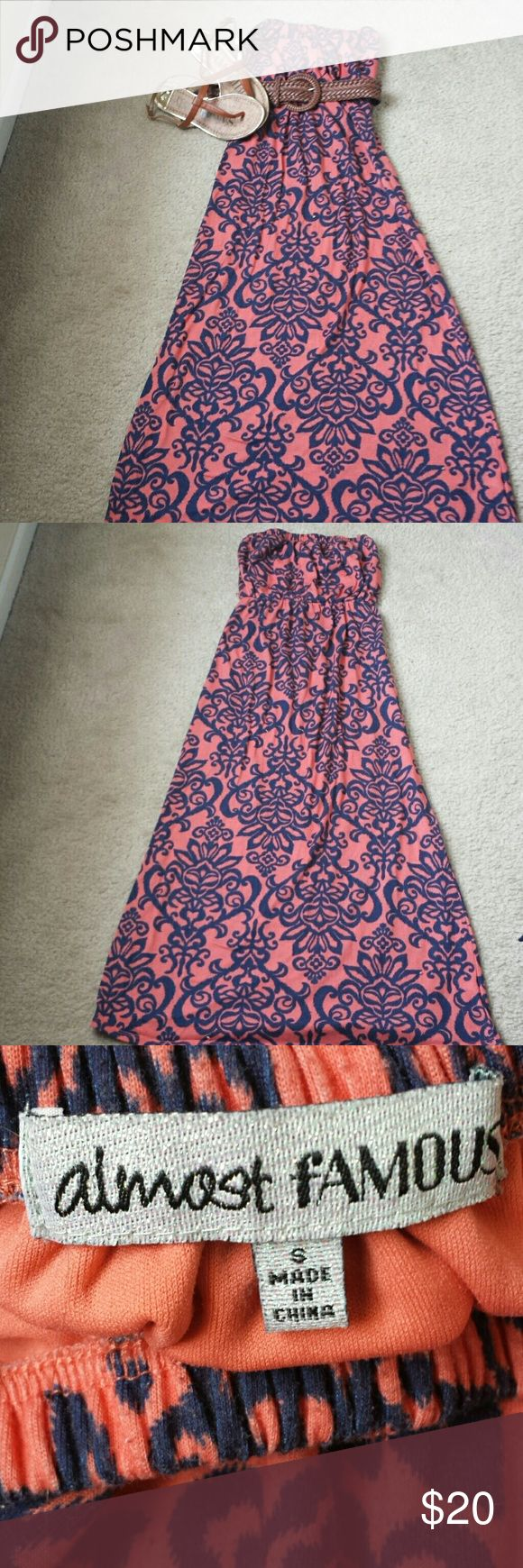 Coral and navy tribal print maxi dress jr/ms small Coral and navy tribal print maxi dress size Jr/Ms small. The dress has 2 string belt loops, 1 on each side. You can choose to wear with or without a belt. Almost Famous Dresses Maxi