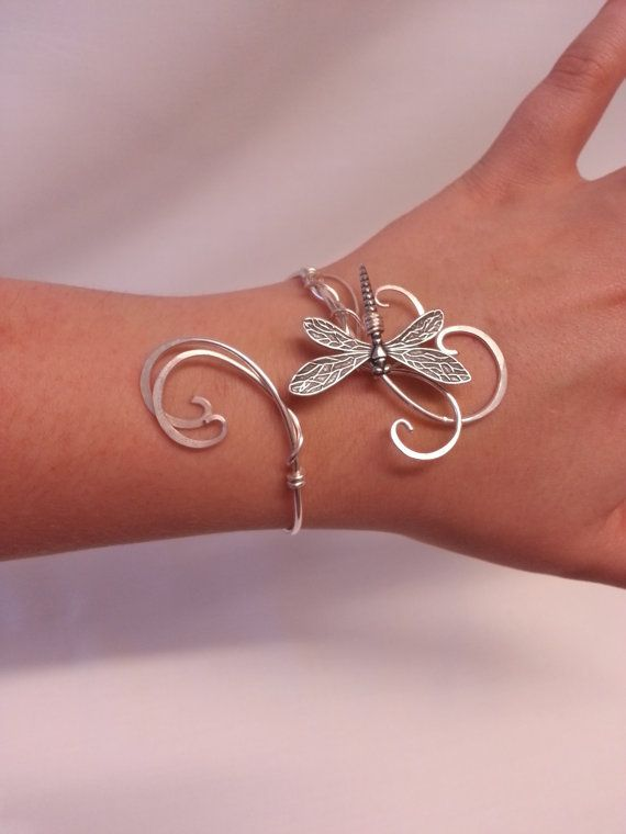 This is handmade dragonfly cuff bracelet made from silver plated metal intricately woven together to create this lovely elven inspired cuff