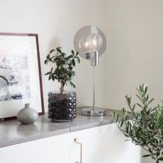 Modern and elegant chromed design table lamp Gloria designed by Malin Lundmark