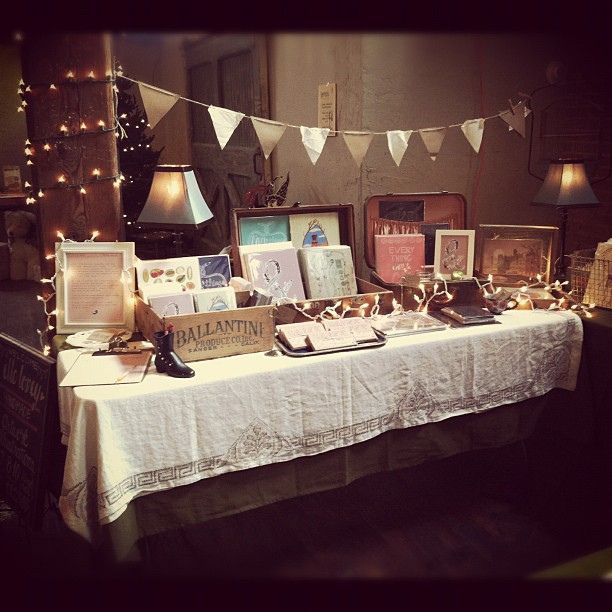 love the tablecloth, lights, and vintage display items