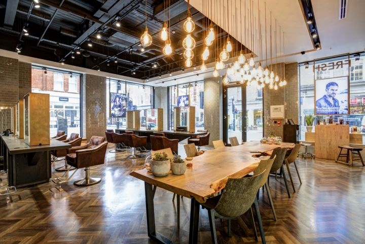The design incorporates an eclectic mix of tactile materials including a reclaimed indian hand carved arch, rusted corten steel panels, concrete wall finishes, vintage brass mesh detailing and the iconic 4 metre long tree-trunk feature table made from a single sheet of sustainably sourced English chestnut to create a sophisticated, understated Eco-Luxe style.