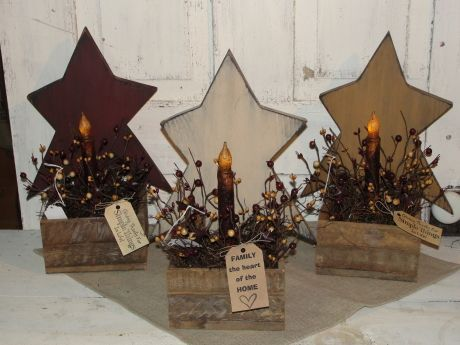 I have added one of my primitive stars to a lath box with battery taper lights and assorted berries. They are shown in burgundy, ivory and spice tan with black underneath the topcoat. You also have your choice of a regular battery operated taper or a grungy timer taper (both require 2 AA batteries - NOT included) . Nice accent to country primitive decorating. Stars will come painted with black underneath and then distressed for a primitive look. Measures 9 x 14 Timer candle optional ~ ...
