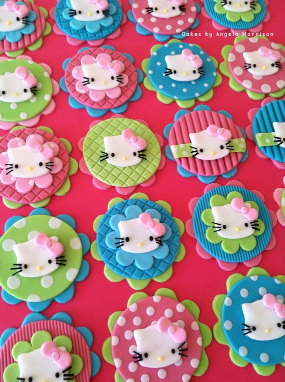 Set of Hello Kitty cupcake/cookie toppers by CakesbyAngela on Etsy, $56.00