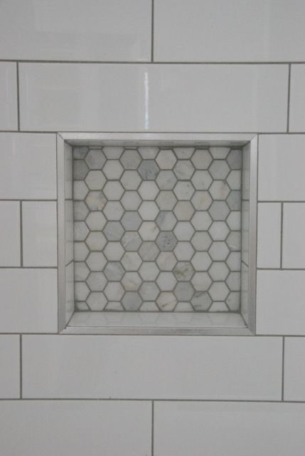 bathroom design: subway tile with dark gray grout + marble hex tile niche >> via the sweetest digs <<
