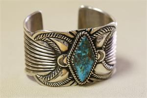 Ernie Lister (Navajo) Ingot Silver Cuff with Red Mountain Turquoise Cuff, Repousse Quarter Moons and Design