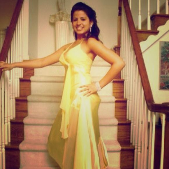 Long Yellow Prom Dress I'm selling a long yellow prom dress. It's in great condition. Of course only wore it once, but it's great to wear for your upcoming prom :) Dresses