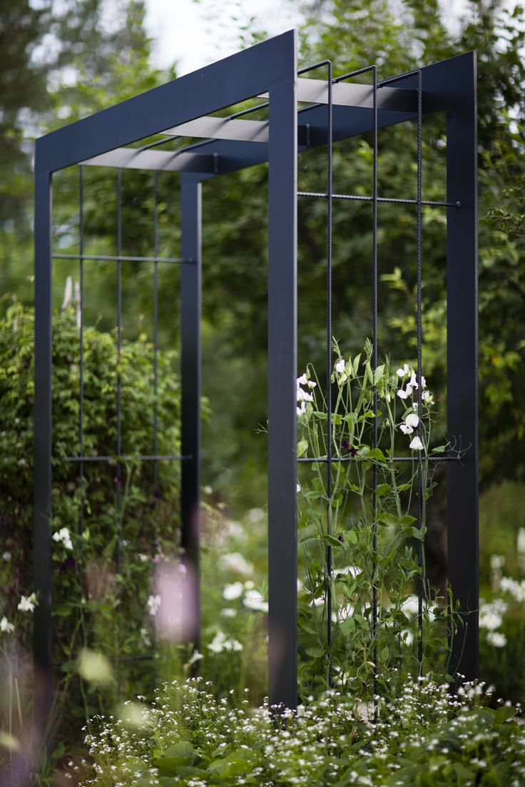 Simple steel arbour. Pinned to Garden Design - Pergolas by Darin Bradbury.