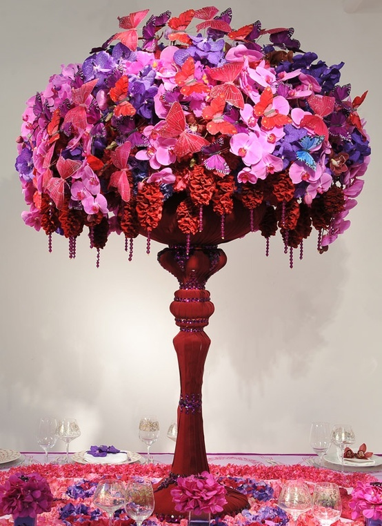 Amazing pink purple floral centerpiece mixed with