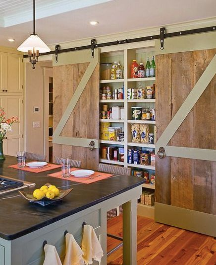 Shallow pantry covered by sliding barn doors