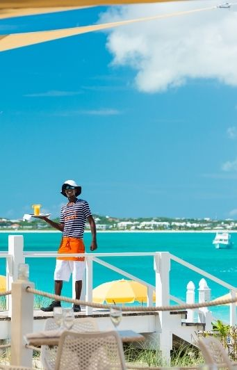 Beach food & beverage service (with a big smile) at Alexandra Resort, Grace Bay Beach, Turks & Caicos