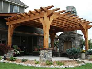 Pergola, fireplace- WOW With the stone at the bottom. My backyard would love one of these :)