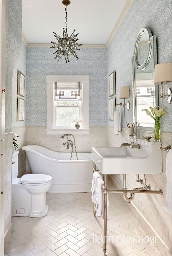"Thibaut's ""Tulsi Block Print"" wallcovering creates a soothing palette of aqua and white in this peaceful bath. - Photo: Dustin Peck / Design: Lisa Mende"