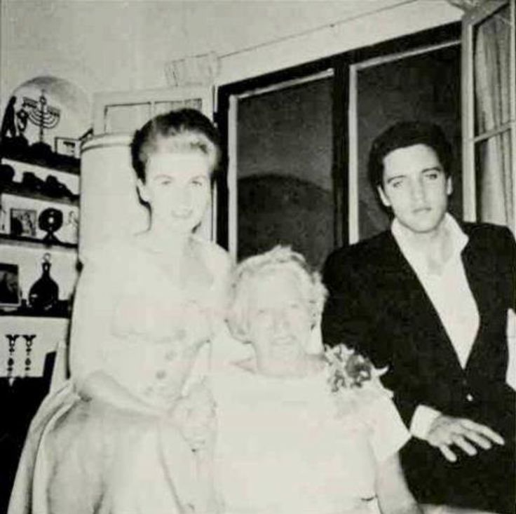 This photo shows Ann-Margret with her Danish landlady, Mrs. Jørgensen, and Elvis. Ann-Margret and Elvis stopped by to wish her a happy birthday at Elvis's suggestion. Mrs. Jørgensen's husband, a sea captain, had just passed away, and Elvis wanted to cheer her up.