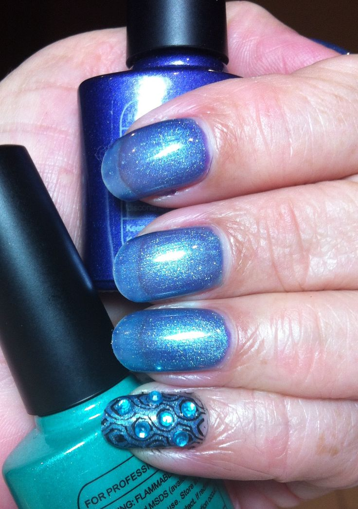 Nails Shellac layering 40530 Purple Purple, & 40539 Hotski Tchotchke  Pinky stamped and bedazzled with turquoise jewels