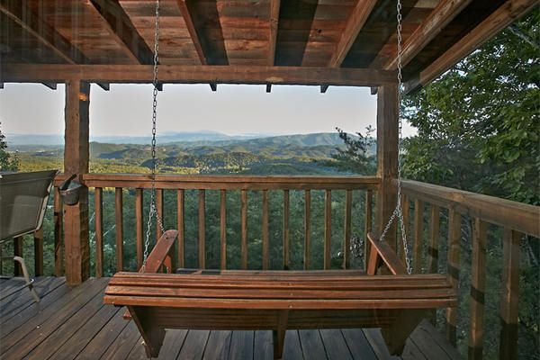 Running Bear - Amazing Panoramic Mountain Views - Relax and enjoy a cup of coffee while easing into your day with an amazing sunrise in the morning, then wind down in the evening while you sit back and take in the glimmering city lights over Pigeon Forge either in the Hot Tub or in the deck's porch swing. #beautiful #view #smokies