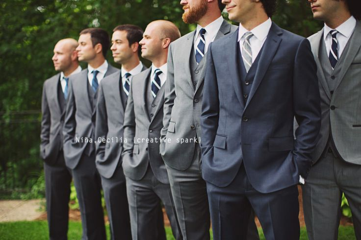 Groom & groomsmen pose, different color tux on groom?