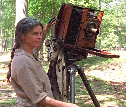 SALLY MANN  an American photographer, best known for her large black-and-white photographs—at first of her young children, then later of landscapes suggesting decay and death
