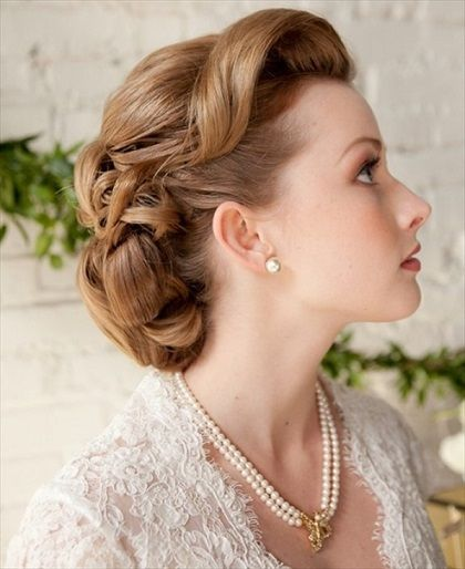 Vintage-inspired wedding hair. Bird cage veil and blinged out hair clip to complete the look.