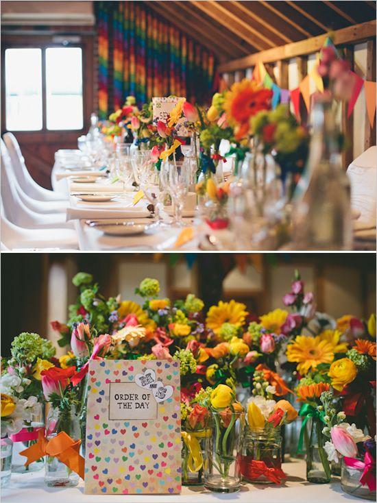 rainbow wedding. I love the rainbow cloth on the back wall