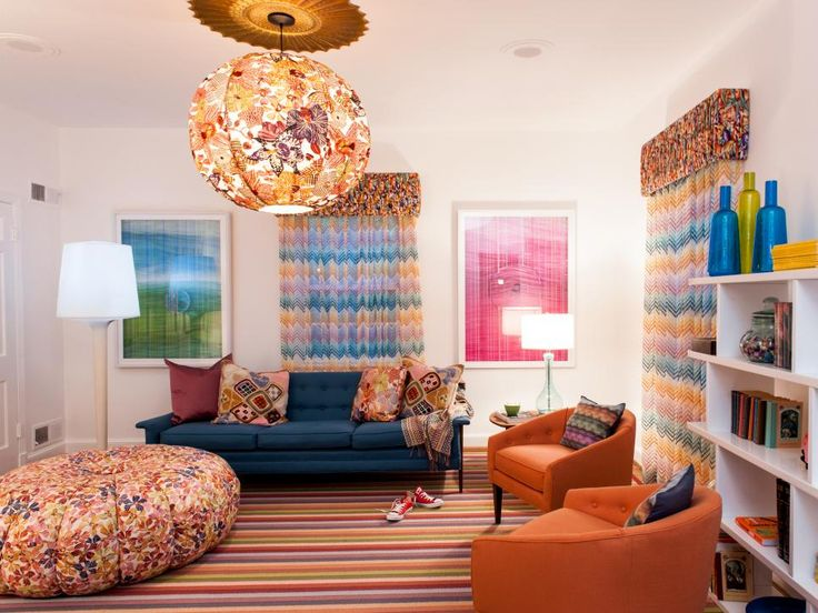 A deep orange base is the jumping off point for the other colors in this fun teen girl's room, like pink, green and blue.