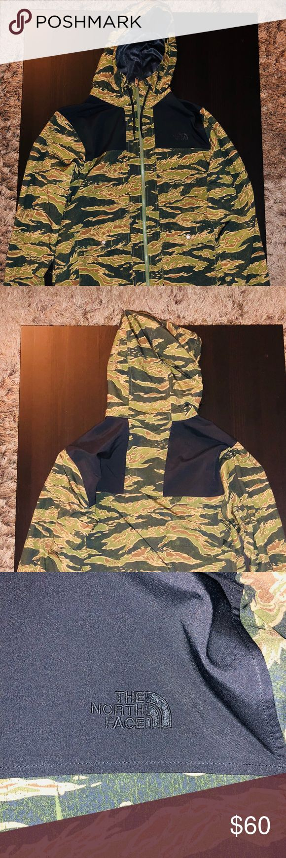 """North Face Mountain Camo Jacket North Face Mountain Camo Jacket  Sizzle: Medium Retail: $140  Authentic North Face Metro Mountain Camo Jacket with hood and black accents and white fleece lining.  Gently used and in excellent condition.  99% Polyester Pit to pit: approx. 21.5"""" Shoulder length: approx. 28"""" Sleeve inseam: approx. 23"""" North Face Jackets & Coats Performance Jackets"""