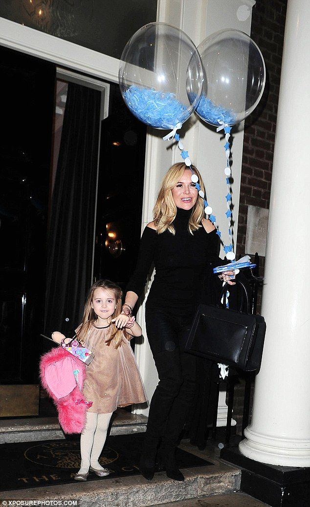 Party time! Amanda Holden and her daughter Hollie, four, helped Eric Cowell celebrate his ...