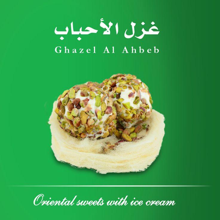 Ghazel el Ahbeb (Kashta ice cream with pistachio, ghazel).  White #cottoncandy topped with two scoops of kashta #icecream.