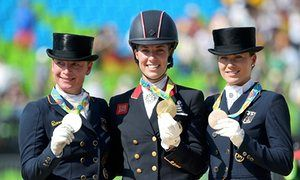 Charlotte Dujardin (centre) with her gold medal, alongside silver medallist…