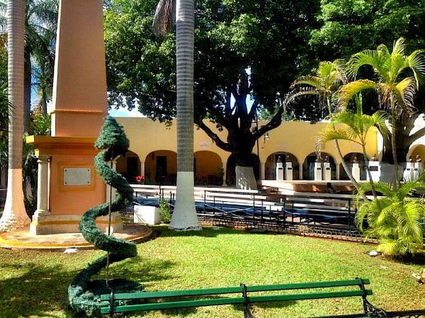 A delightfully quaint colonial plaza that includes a church, park, eateries & shops.