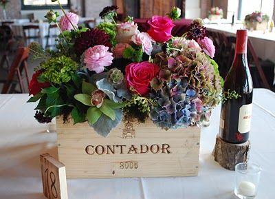 antique hydrangea, cymbidium orchids, roses, ranuculus, scabiosa, and scabiosa pods, privet, hypericum, and amaranthus