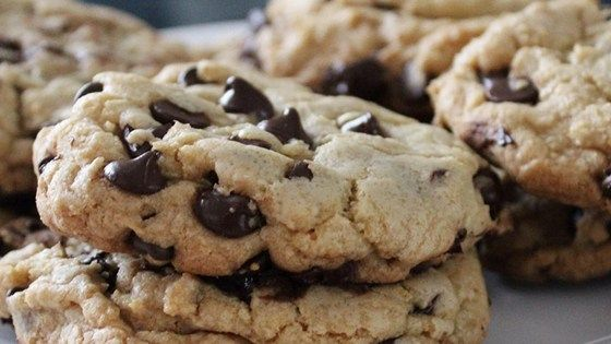 Make bakery-style chocolate chip cookies with these tips. Pull dough balls apart and put together with jagged sides up; ball should be taller than wide. Consider using cinnamon.