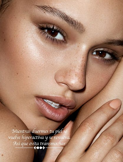 Dewy look. Natural retouching. Model adds interest in her expression & look, which are highlighted by the composition & lighting of the image.