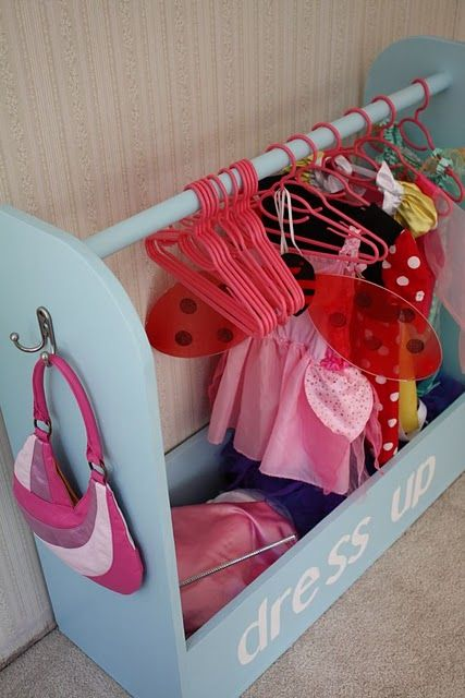this is so clever!  much better than the box i have the girl's dress up clothes shoved in.  it cost them $15 to make.  i would love to make this for my girls.