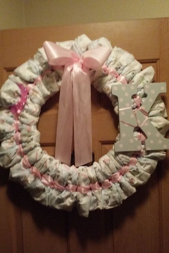 repin and follow me for a 10% off coupon to my etsy shop! perfect diaper wreath for any baby shower. can be used as decoration for the shower and functional use for after the shower; make the letter the theme of the baby's bedroom and it can be used as a decoration later! plus, we all know diapers come in handy! can make any color scheme!