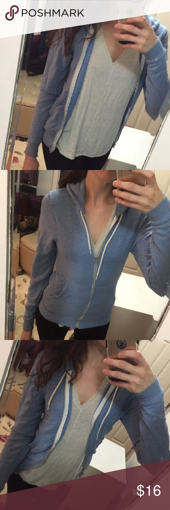 American Apparel zip up hoodie jack Blue heathered zip up hoodie from American Apparel. Worn a few times but in good condition. Has a dingy sleeve that needs some stain removal, but I didn't even notice it until I went to list it. American Apparel Jackets & Coats