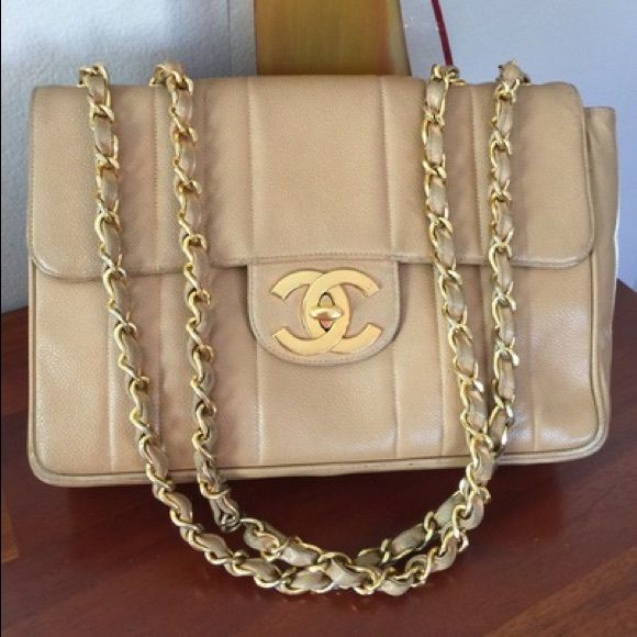 """Authentic Chanel Caviar Beige Vintage Jumbo Flap Authentic Chanel Caviar Beige Vintage Jumbo Flap. This is in excellent condition, minor signs of wear. Please look at all the photos! This bag is absolutely gorgeous! Measures 12"""" x 3.5"""" x 9"""" with an 12.5"""" strap drop. Retail right now is $4900 plus tax. CHANEL Bags"""