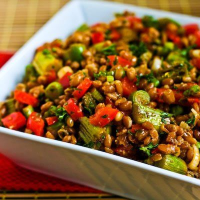 A delicious Farro Salad with Asparagus, Red Bell Pepper, and Sun-Dried Tomato Vinaigrette.