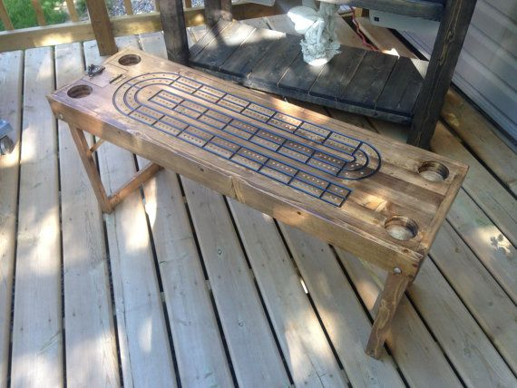 Large Cribbage Board; Great addition to the deck, cabin, or out camping. Solid wood construction with dark walnut stain and finish. This table stands 20 tall, 44 Long, and 13.5 Wide. Comes with 4 drink holders, large playing pegs, card storage, and folding legs for easy storage (3 Ht with legs in). Personalized Name or small design/logo included; Just add details in message or contact me for clarification. Custom Order Request: Custom orders accepted; contact seller for a quote and ship...