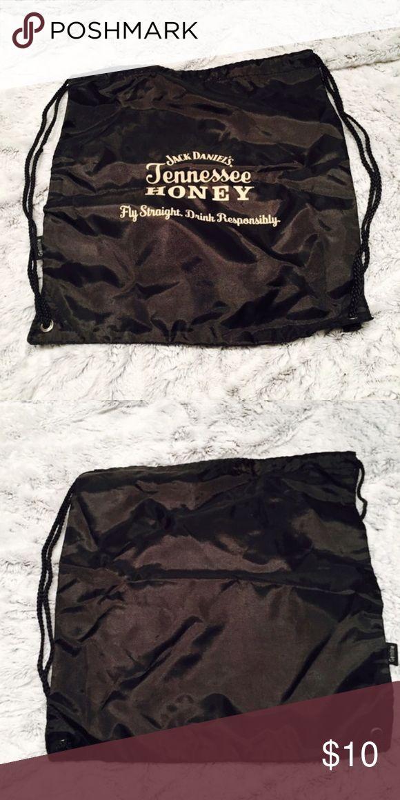Jack Daniels backpack Jack Daniels Honey drawstring backpack. Never used. Black with cream colored writing. Jack Daniels Honey  Bags Backpacks