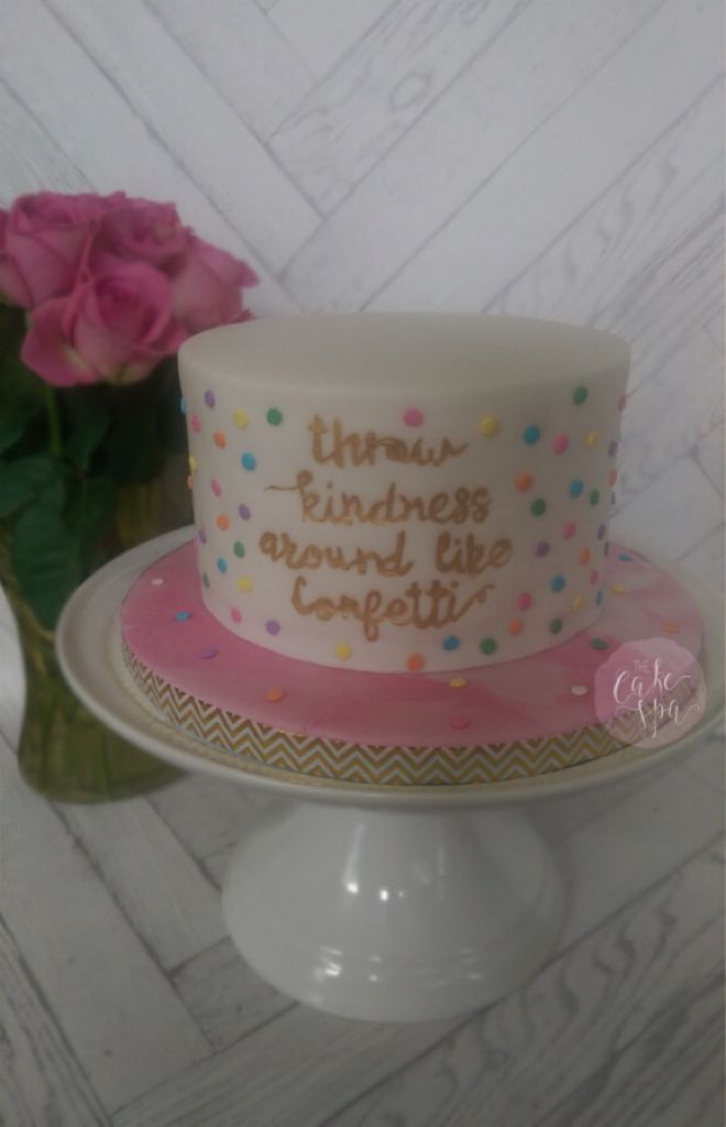 My throw kindness around like confetti quote cake with hand painted gold text
