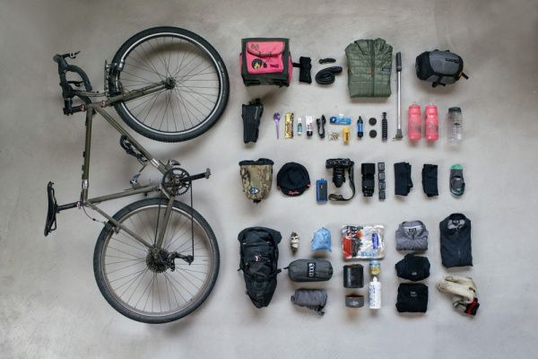 A bike packing list can be minimal or extensive. It should take into account days in the saddle, miles between stops, and possible combinations of weather.