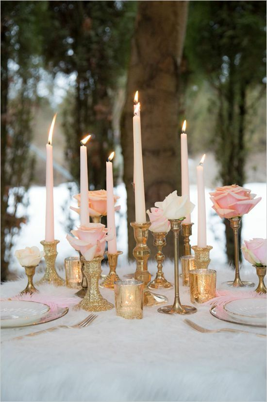 Gold candle holders with pink roses and long white candles - so simple and chic