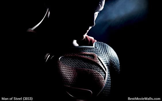 Man of Steel movie wallpaper featuring Ka'el with a ray of light on his face on a dark background.