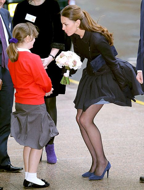 Royal wardrobe malfunction! Kate Middleton had a Marilyn moment when her skirt got lifted up in the wind today, but somehow she still managed to look as poised and graceful as always.