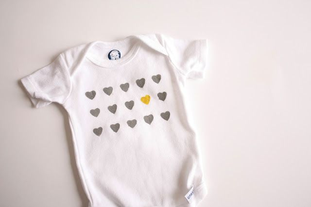 Darling onesie embellishment using freezer paper stencil and a heart punch.