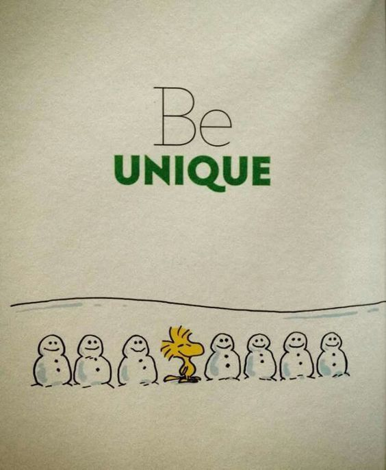 Be Unique...Woodstock Sitting on the Middle of a Group of Snowmen