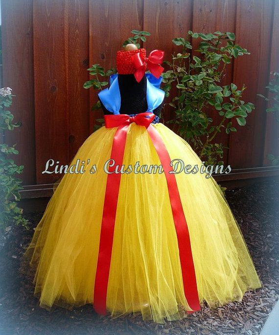 measurement and tulle Cut the elastic to your child's measurement fold the elastic so that the ends meet and overlap  cut strips of tulle double the size of your desired length a .