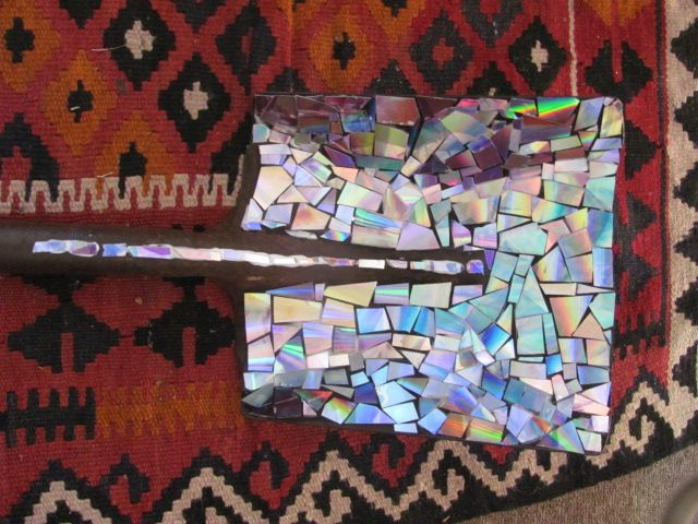 Repurposed high tech meets junkyard find! a rusty old spade I mosaic-ed with cut up dvd's ...and the carpet just says far-out!