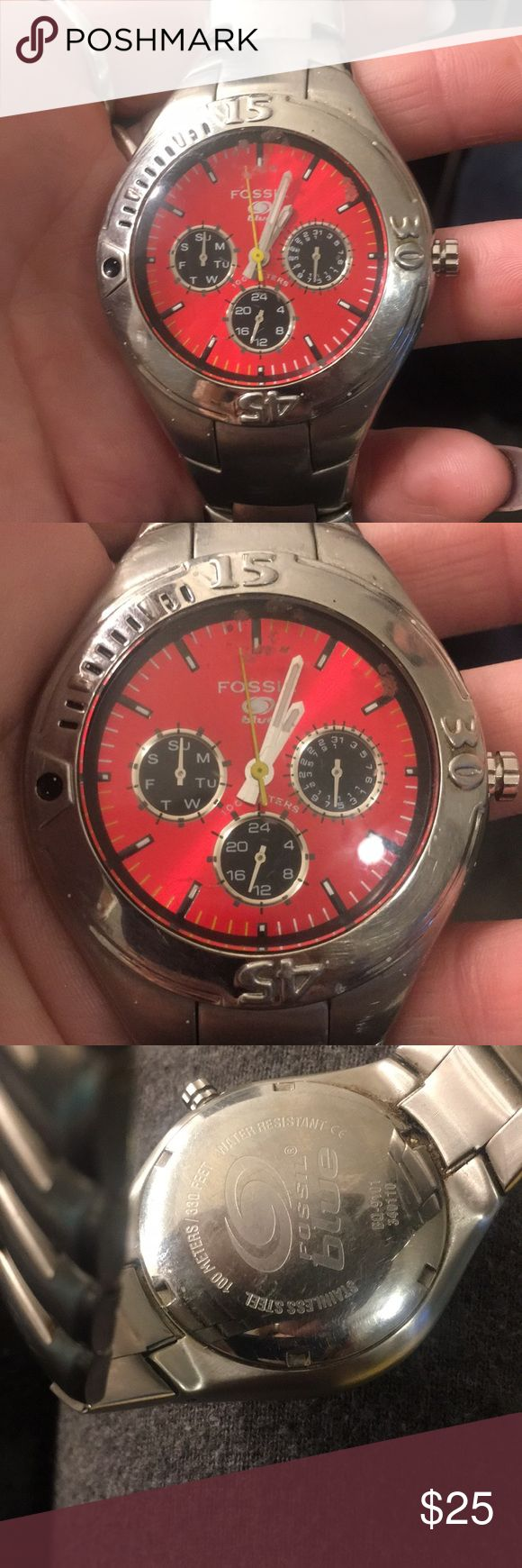 Fossil blue watch Used fossil watch , stainless steel with red face . Watch does not work. Serial number on back. Fair condition Fossil Accessories Watches