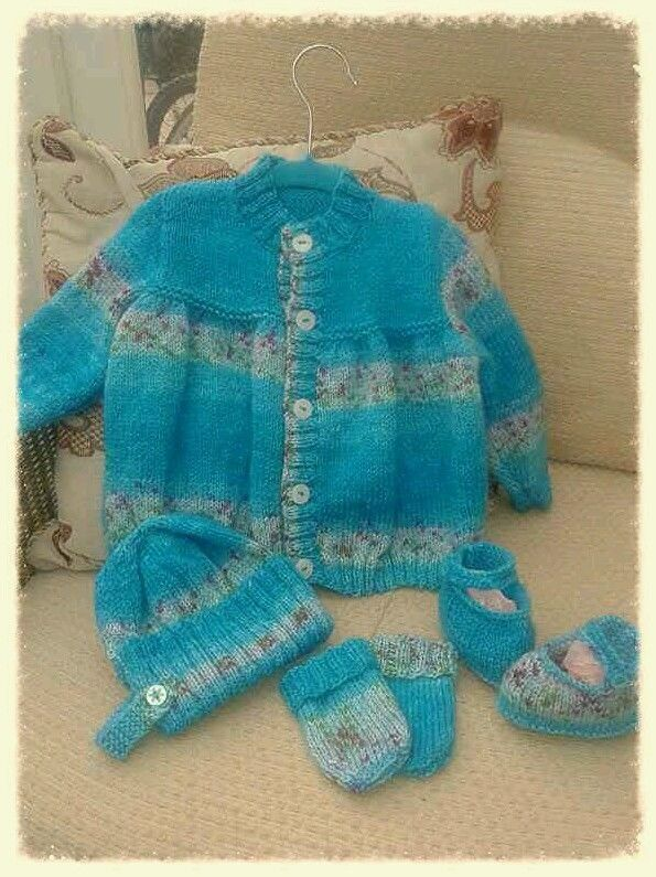 Hand knitted cardigan set.